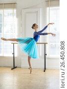 Купить «Ballerina is training in hall», фото № 26450808, снято 9 мая 2016 г. (c) Andriy Bezuglov / Фотобанк Лори