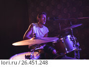 Купить «Singer playing drums while performing in nightclub», фото № 26451248, снято 7 марта 2017 г. (c) Wavebreak Media / Фотобанк Лори