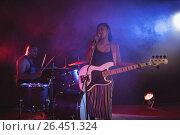 Купить «Singer and drummer performing in illuminated nightclub», фото № 26451324, снято 7 марта 2017 г. (c) Wavebreak Media / Фотобанк Лори