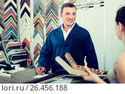Купить «portrait of man seller taking order on picture frame from custom», фото № 26456188, снято 21 октября 2018 г. (c) Яков Филимонов / Фотобанк Лори