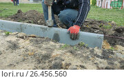 Купить «Mtsensk, Russia 23 May 2017. EDITORIAL - Construction, reconstruction of the pedestrian zone - pavement. Ultra HD 4K», видеоролик № 26456560, снято 19 ноября 2017 г. (c) Константин Мерцалов / Фотобанк Лори