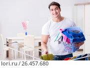 Купить «Man doing laundry at home», фото № 26457680, снято 6 марта 2017 г. (c) Elnur / Фотобанк Лори