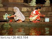 Купить «Two Indian women at the ganges, India, Ganges», фото № 26463164, снято 5 июля 2020 г. (c) age Fotostock / Фотобанк Лори