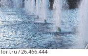 Купить «Beautiful fountain in the city park. The sun illuminates the splashes of water. Shining splash of water.», видеоролик № 26466444, снято 2 июня 2017 г. (c) Игорь Усачев / Фотобанк Лори