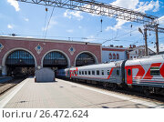 Купить «Train on Kazansky railway terminal ( Kazansky vokzal) -- is one of nine railway terminals in Moscow, Russia. Construction of the modern building according to the design by architect Alexey Shchusev started in 1913 and ended in 1940», фото № 26472624, снято 18 июня 2015 г. (c) Владимир Журавлев / Фотобанк Лори