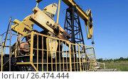 Купить «The pumping unit on a well. Equipment of oil wells.», видеоролик № 26474444, снято 22 января 2017 г. (c) Леонид Еремейчук / Фотобанк Лори