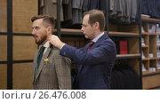 Купить «Customer and tailor in atelier», видеоролик № 26476008, снято 2 июня 2017 г. (c) Raev Denis / Фотобанк Лори