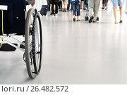 Купить «Кресло-коляска на фоне людей, идущих из самолета к выходу из аэропорта», фото № 26482572, снято 23 июля 2009 г. (c) Александр Гаценко / Фотобанк Лори