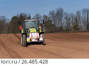 Купить «Planting seed potato in freshly prepared seed bed using a Grimme seed drill pulled by a Claas ARES 816RZ tractor, Yorkshire, UK. (Photo by: Wayne Hutchinson/Farm Images/UIG)», фото № 26485428, снято 18 февраля 2019 г. (c) age Fotostock / Фотобанк Лори