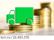 Купить «Грузовой автомобиль на фоне денег», фото № 26493376, снято 12 февраля 2016 г. (c) Сергеев Валерий / Фотобанк Лори