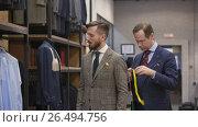 Купить «Working tailor in the studio», видеоролик № 26494756, снято 5 июня 2017 г. (c) Raev Denis / Фотобанк Лори