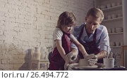 Купить «Father and son in a pottery workshop», видеоролик № 26494772, снято 20 ноября 2018 г. (c) Raev Denis / Фотобанк Лори