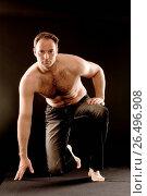 Купить «Man doing yoga», фото № 26496908, снято 20 февраля 2020 г. (c) age Fotostock / Фотобанк Лори