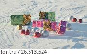 Купить «Christmas gifts in a field on snow in a sunny, frosty and clear weather outdoors», видеоролик № 26513524, снято 9 мая 2017 г. (c) Mikhail Davidovich / Фотобанк Лори