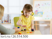 Купить «Kid is playing with toys in nursery», фото № 26514500, снято 20 апреля 2017 г. (c) Оксана Кузьмина / Фотобанк Лори