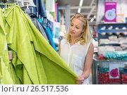 Купить «Woman choosing the right towel for her apartment in a modern home furnishings store», фото № 26517536, снято 15 сентября 2019 г. (c) Matej Kastelic / Фотобанк Лори