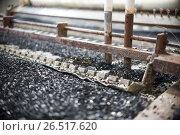 Купить «Industrial tinning of wire. Bath with molten solder», фото № 26517620, снято 3 апреля 2017 г. (c) Андрей Радченко / Фотобанк Лори