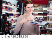 Купить «cheerful woman customer deciding on make-up items in cosmetics shop», фото № 26518856, снято 21 февраля 2017 г. (c) Яков Филимонов / Фотобанк Лори