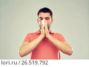 Купить «sick man with paper napkin blowing nose», фото № 26519792, снято 15 января 2016 г. (c) Syda Productions / Фотобанк Лори