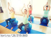 Купить «happy pregnant women exercising on fitball in gym», фото № 26519860, снято 5 марта 2016 г. (c) Syda Productions / Фотобанк Лори
