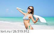 woman in bikini and sunglasses with pareo on beach. Стоковое фото, фотограф Syda Productions / Фотобанк Лори