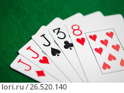 Купить «poker hand of playing cards on green casino cloth», фото № 26520140, снято 15 марта 2017 г. (c) Syda Productions / Фотобанк Лори