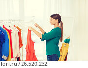 Купить «happy woman choosing clothes at home wardrobe», фото № 26520232, снято 19 февраля 2016 г. (c) Syda Productions / Фотобанк Лори