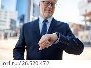 Купить «senior businessman with wristwatch on city street», фото № 26520472, снято 16 июля 2016 г. (c) Syda Productions / Фотобанк Лори