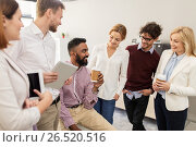 Купить «happy business team drinking coffee at office», фото № 26520516, снято 1 октября 2016 г. (c) Syda Productions / Фотобанк Лори