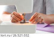 Купить «tailor woman threading needle of sewing machine», фото № 26521032, снято 29 сентября 2016 г. (c) Syda Productions / Фотобанк Лори