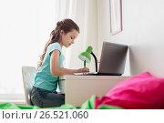 Купить «girl with laptop writing to notebook at home», фото № 26521060, снято 5 ноября 2016 г. (c) Syda Productions / Фотобанк Лори