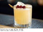 Купить «glass of cocktail with cherries at bar», фото № 26521116, снято 7 февраля 2017 г. (c) Syda Productions / Фотобанк Лори
