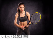 Young girl playing tennis with racket (2017 год). Редакционное фото, фотограф VictorStudio / Фотобанк Лори