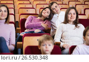 Купить «Teenage couple enjoying film at date», фото № 26530348, снято 3 декабря 2016 г. (c) Яков Филимонов / Фотобанк Лори