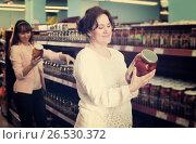 Купить «Ordinary women purchasing pickled vegetables», фото № 26530372, снято 20 января 2019 г. (c) Яков Филимонов / Фотобанк Лори