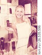 Купить «Woman buying accessorizes», фото № 26535596, снято 16 июля 2019 г. (c) Яков Филимонов / Фотобанк Лори