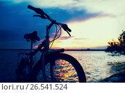 Bicycle near lake during sunset. Стоковое фото, фотограф Dmitriy Melnikov / Фотобанк Лори