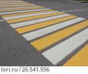 Купить «Бело-желтый пешеходный переход», эксклюзивное фото № 26541556, снято 11 июня 2017 г. (c) lana1501 / Фотобанк Лори