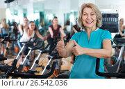 Купить «Mature woman in modern gym», фото № 26542036, снято 18 марта 2019 г. (c) Яков Филимонов / Фотобанк Лори