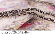 Купить «Clutch with chains», видеоролик № 26542464, снято 5 июня 2017 г. (c) Потийко Сергей / Фотобанк Лори