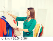 Купить «happy woman choosing clothes at home wardrobe», фото № 26546564, снято 19 февраля 2016 г. (c) Syda Productions / Фотобанк Лори