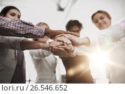 Купить «happy business team with hands on top at office», фото № 26546652, снято 1 октября 2016 г. (c) Syda Productions / Фотобанк Лори