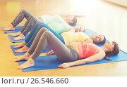 Купить «happy pregnant women exercising on mats in gym», фото № 26546660, снято 5 марта 2016 г. (c) Syda Productions / Фотобанк Лори