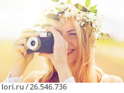Купить «happy woman with film camera in wreath of flowers», фото № 26546736, снято 31 июля 2016 г. (c) Syda Productions / Фотобанк Лори