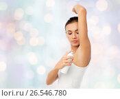 Купить «woman with antiperspirant deodorant over white», фото № 26546780, снято 9 апреля 2017 г. (c) Syda Productions / Фотобанк Лори