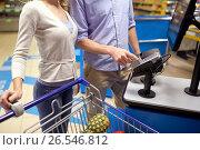 Купить «couple buying food at grocery self-checkout», фото № 26546812, снято 21 октября 2016 г. (c) Syda Productions / Фотобанк Лори