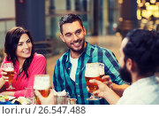 Купить «friends dining and drinking beer at restaurant», фото № 26547488, снято 8 ноября 2015 г. (c) Syda Productions / Фотобанк Лори
