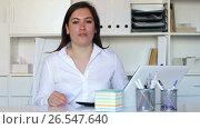 Купить «Portrait of happy businesswoman in modern office interior», видеоролик № 26547640, снято 17 апреля 2017 г. (c) Яков Филимонов / Фотобанк Лори