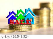 Купить «Cимвол  недвижимости на фоне денег», фото № 26548524, снято 23 марта 2017 г. (c) Сергеев Валерий / Фотобанк Лори