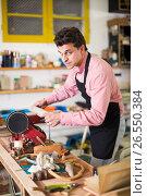 Купить «Craftsman working on woodworking machine», фото № 26550384, снято 8 апреля 2017 г. (c) Яков Филимонов / Фотобанк Лори